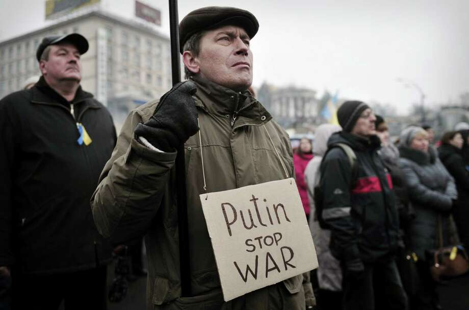 Ukrainians  protest the possibility of Russian military intervention. The threat of military activity drew a stern warning from President Barack Obama, but a reader says there is no substance behind the words. Photo: Louisa Gouliamaki / AFP / Getty Images / AFP