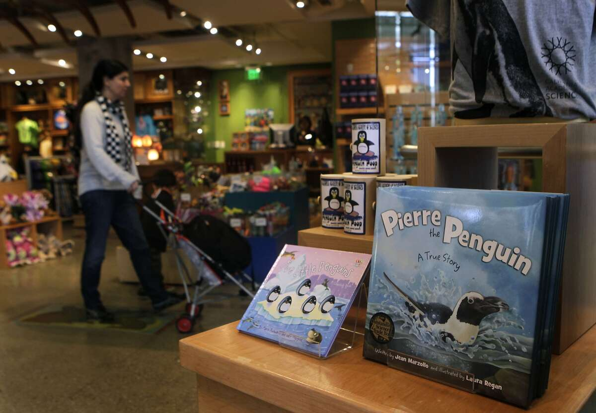 A children's book written by Jean Marzollo, telling the story of Pierre the African penguin, is displayed in a gift shop at the California Academy of Sciences in San Francisco, Calif. on Tuesday, Feb. 25, 2014. Among the residents of the Academy's penguin colony is 31-year-old Pierre, who became famous for wearing a neoprene wetsuit to help his feathers grow back after molting season.