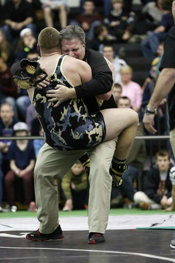 Trumbull High School's Andrew Marino celebrates with his father and coach A.J Marino after Andrew would win his 220 lb weight class match-up over opponent Andrew Cavanna of Glastonbury School during their  during Saturday evening State Open Wrestling Championships at New Haven Floyd Little Athletic Center. Photo: Mike Ross / Mike Ross Connecticut Post freelance - @www.mikerossphoto.com