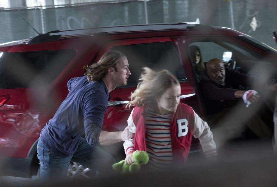 "Intense sci-fi drama ""Believe"" has young Bo (Johnny Sequoyah) and her protector (Jake McLaughlin) constantly on the run from villains who hope to capitalize on her special powers. Photo: NBC / 2013 NBCUniversal Media, LLC."