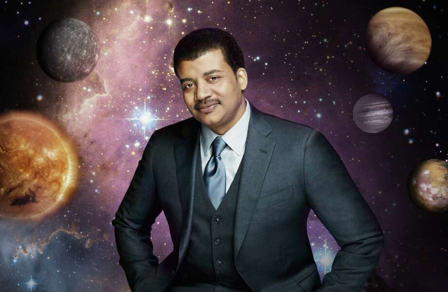 "Renowned astrophysicist Neil deGrasse Tyson hosts ""Cosmos: A Spacetime Odyssey,"" a 13-part epic adventure that will transport viewers across the universe. Photo: Fox / © 2014 FOX BROADCASTING"