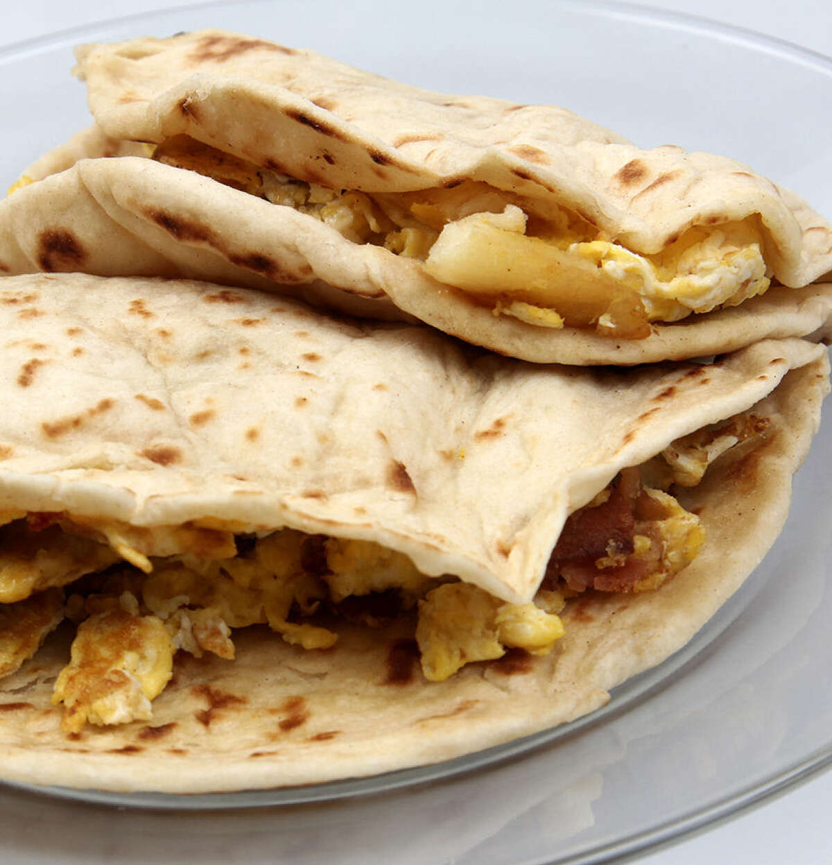 Take your pick with breakfast tacos: bacon and egg (left) and potato and egg.