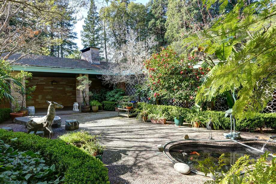 The courtyard includes a koi pond, bonsai trees and shrubs. Photo: Liz Rusby/The Grubb Co.