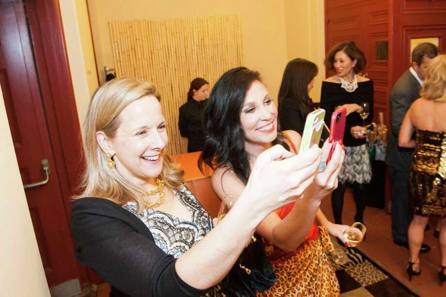 Marie Crouch and Michelle Molfino snap a phone pic during Zootopia 2014 in the San Francisco Zoo's historic Lion House on February 26, 2014. Photo: Susana Bates For Drew Altizer, Drew Altizer Photography / Drew Altizer Photography