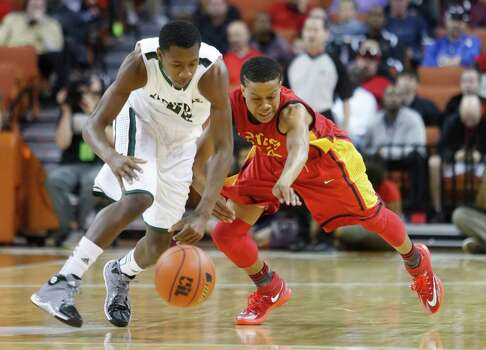 Kennedale's VJ Hughes, left, and Houston Yates' Jacob Young reach for the ball during a boys' UIL Class 3A state basketball semifinal, Thursday, March 6, 2014, in Austin, Texas. (AP Photo/ Tamir Kalifa) Photo: Tamir Kalifa, Associated Press / FR170773 AP
