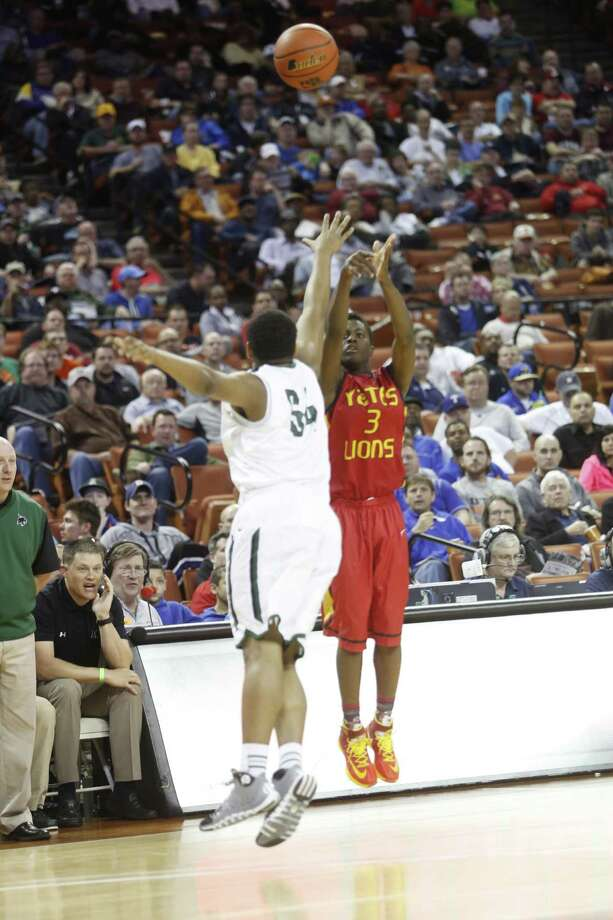 Kennedale's Aundre Jackson (54) attempts to block a shot by Yates' Lorenzo Philips (3) during a boys UIL Class 3A state basketball semifinal, Thursday, March 6, 2014, in Austin, Texas. (AP Photo/ Tamir Kalifa) Photo: Tamir Kalifa, Associated Press / FR170773 AP
