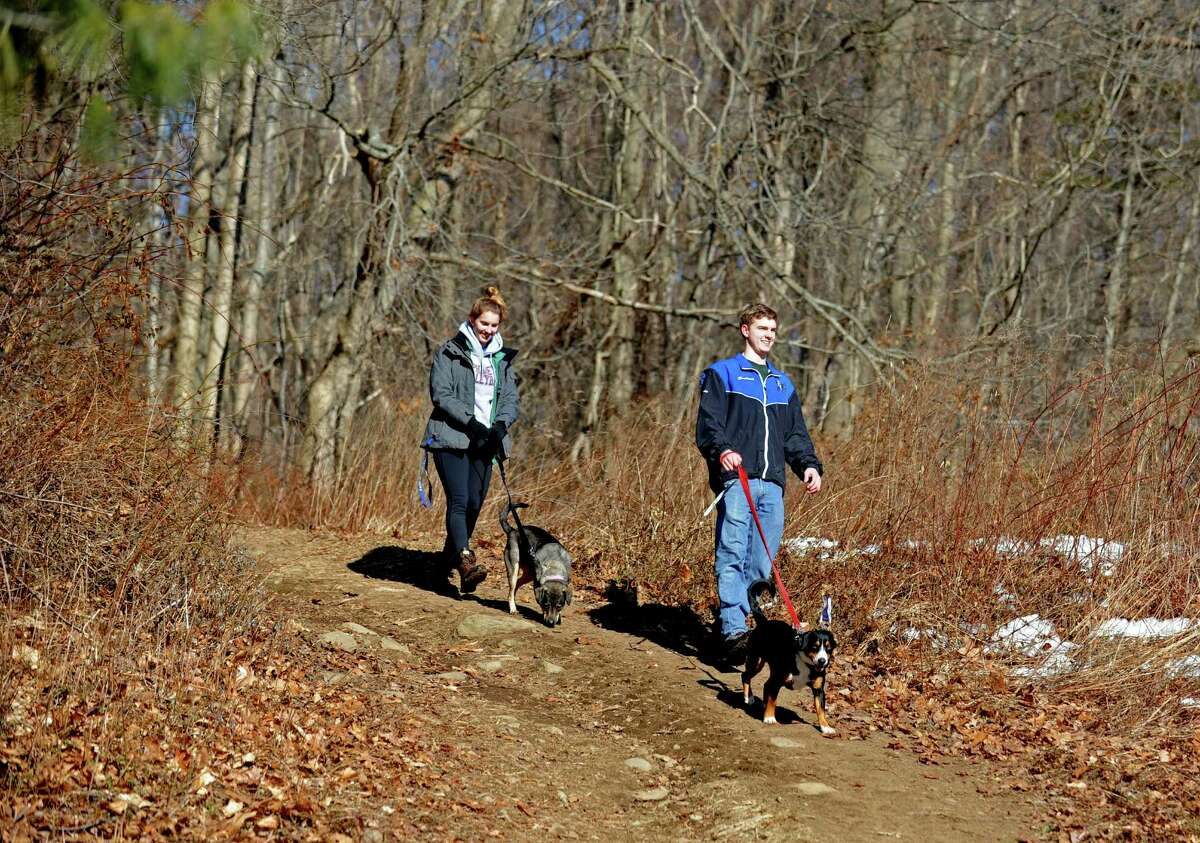 Lake Mohegan (suggested by Heidi Hackney) Lauren Schreiber, 18, walks her dog Roxy with friend Charlie Haviland, 17, of Fairfield, and his dog Rocky Thursday, Mar. 6, 2014, at Lake Mohegan's hiking trails in Fairfield, Conn.