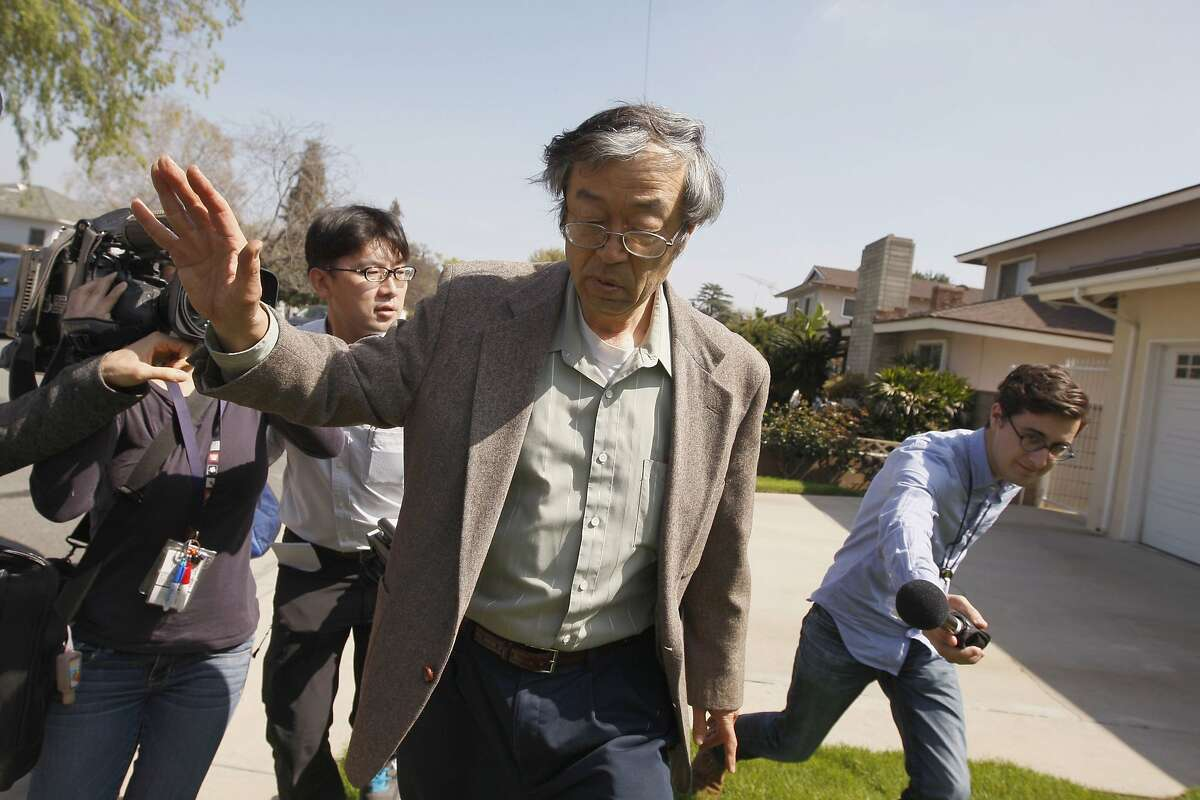 Satoshi Nakamoto is surrounded by reporters as he leaves his home in Temple City, California, March 6, 2014. The reclusive Japanese American man, thought to be the father of Bitcoin, emerged from his Southern California home and denied any involvement with the digital currency, before leading reporters on a car chase leading to the headquarters of the Associated Press. Bitcoin is a digital currency that, unlike conventional money, is bought and sold on a peer-to-peer network independent of central control. Its value soared last year, and the total worth of bitcoins minted is now about $7 billion. REUTERS/David McNew (UNITED STATES - Tags: BUSINESS TPX IMAGES OF THE DAY)