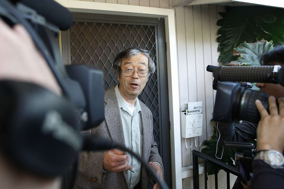 A man widely believed to be Bitcoin currency founder Satoshi Nakamoto is surrounded by reporters as he leaves his home in Temple City, California March 6, 2014. REUTERS/David McNew (UNITED STATES - Tags: BUSINESS TPX IMAGES OF THE DAY)