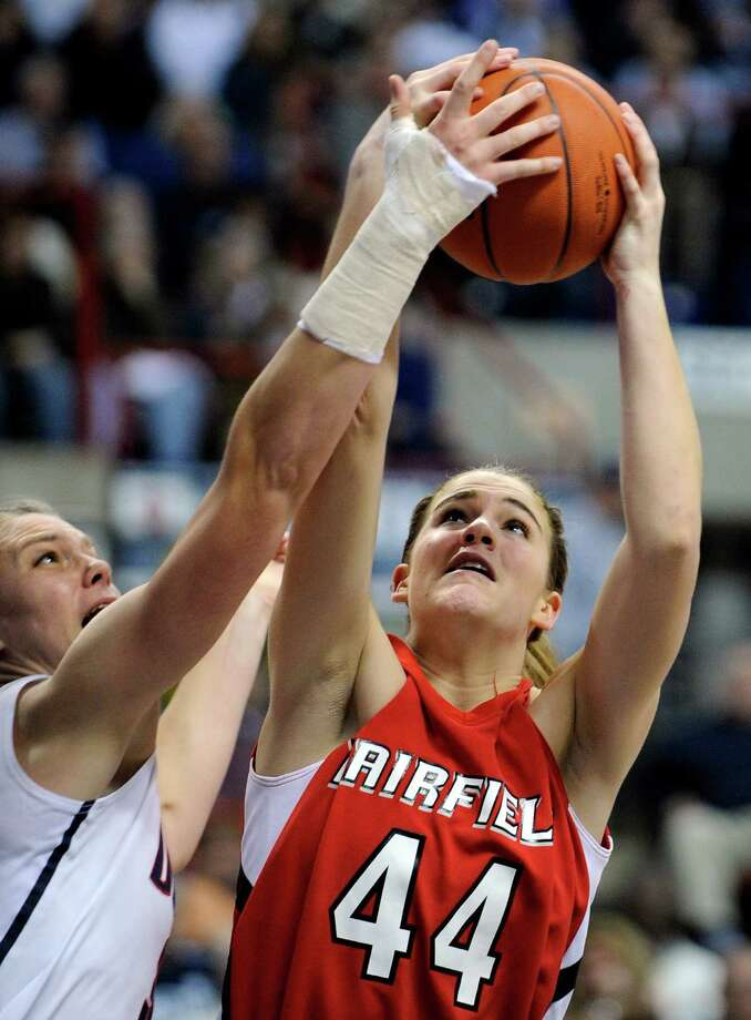 Fairfield's Katie Cizynski, right, fights for a rebound with Connecticut's Heather Buck during the second half of an NCAA college basketball game in Storrs, Conn., on Thursday, Dec. 29, 2011. Connecticut won the game 93-40. (AP Photo/Fred Beckham) Photo: Fred Beckham, Associated Press / Associated Press