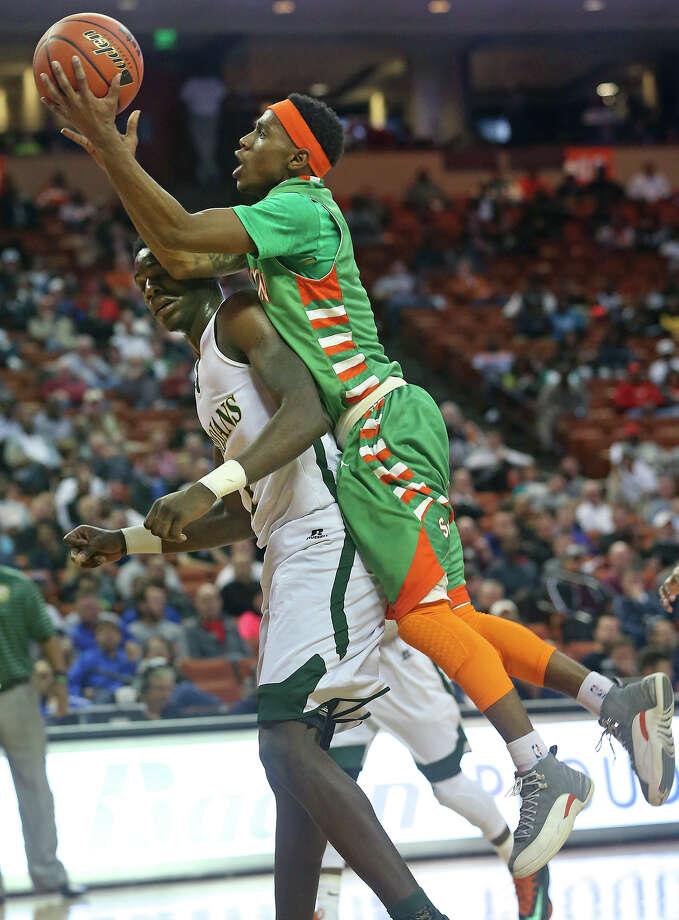 Hurricane guard Jordon Harris gets on the back of center Johnathan Turner as Sam Houston plays Dallas Madison at the Erwin Center in Austin in the state semifinals for 3A basketball on March 6, 2014. Photo: Tom Reel, San Antonio Express-News