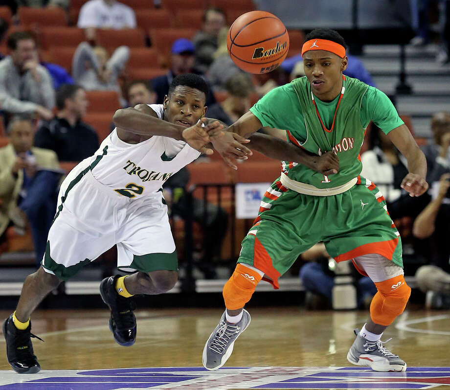 Jordon Harris (right) sees the ball fly away under reach in pressure from Cameron Bryant as Sam Houston plays Dallas Madison at the Erwin Center in Austin in the state semifinals for 3A basketball on March 6, 2014. Photo: Tom Reel, San Antonio Express-News