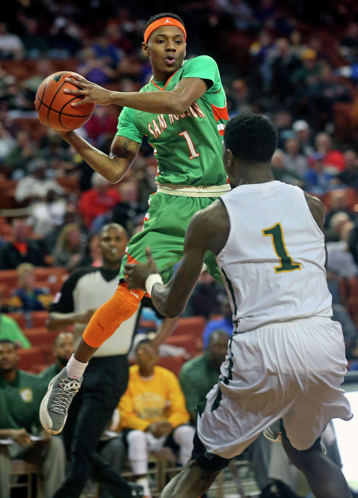 Hurricane guard Jordon Harris looks around mid air as Sam Houston plays Dallas Madison at the Erwin Center in Austin in the state semifinals for 3A basketball on March 6, 2014.