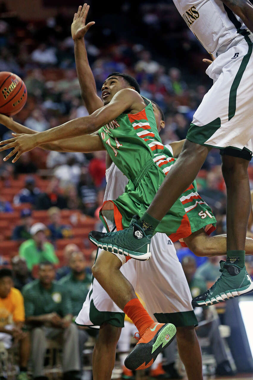 Jawon Anderson tries an off balance runner against heavy pressure as Sam Houston plays Dallas Madison at the Erwin Center in Austin in the state semifinals for 3A basketball on March 6, 2014.