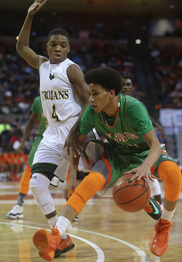 Hurricane forward Robert Christian pulls up under Brandon Stanton as Sam Houston plays Dallas Madison in the state semifinals for 3A basketball on March 6, 2014. Photo: Tom Reel, San Antonio Express-News