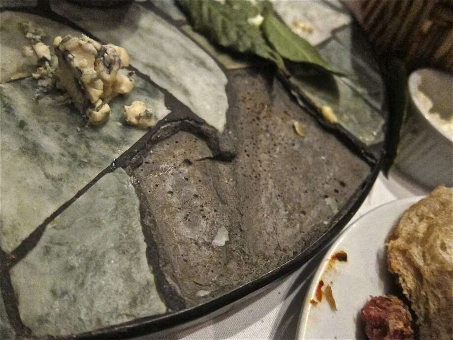 Missing tile from cheese platter at Cafe Rabelais. Photo: Alison Cook