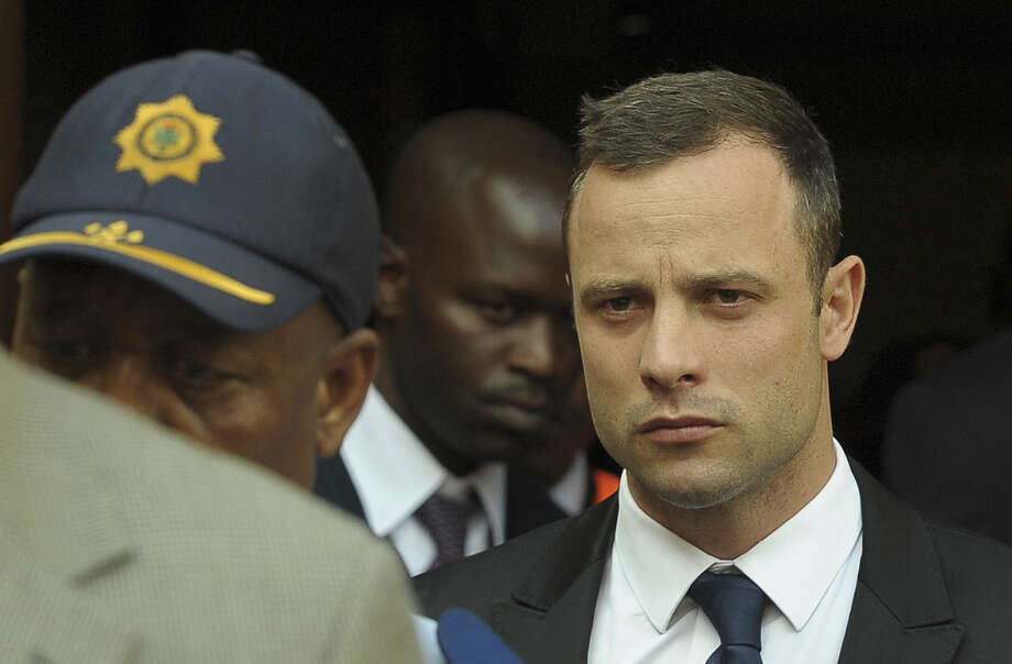Oscar Pistorius leave the  Pretoria's North Gauteng High Court  on March 6, 2014, on the 4 th day South African amputee Olympian sprinter Oscar Pistorius' murder trial, accused of murdering his girlfriend Reeva Steenkamp. Pistorius, 27, to answer charges that he willfully shot his girlfriend Reeva Steenkamp dead on Valentine's Day 2013 through a locked bathroom door at his home in the city, and faces a life sentence if convicted. AFP PHOTO / ALEXANDER JOEALEXANDER JOE/AFP/Getty Images Photo: ALEXANDER JOE / AFP