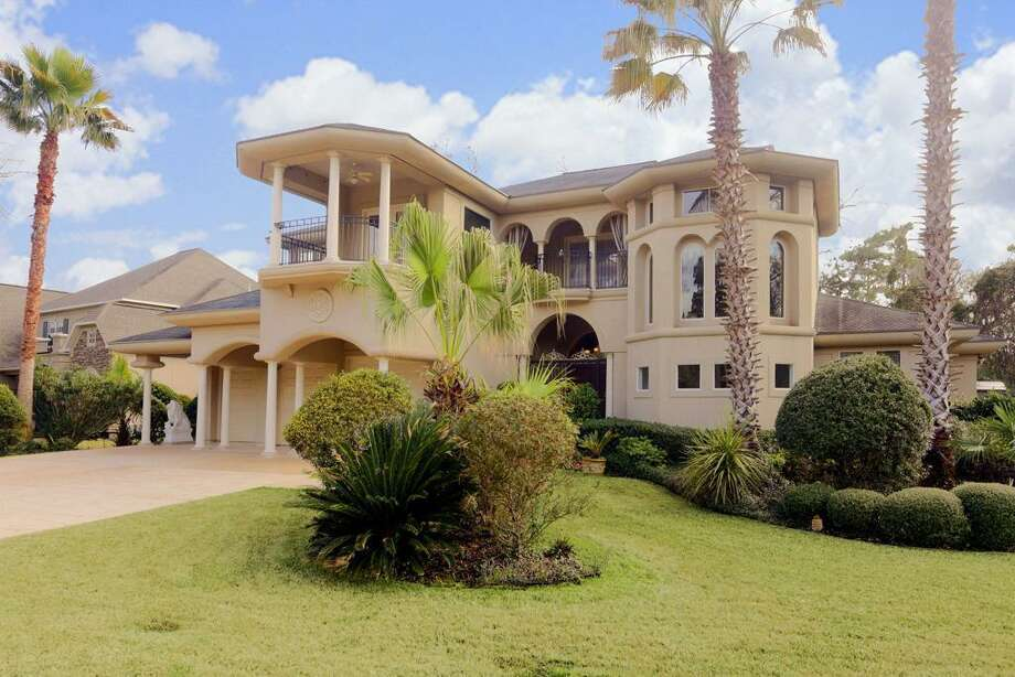 This custom home is nestled in the prestigious Stonecroft neighborhood.