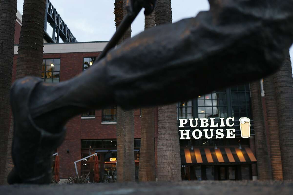 The Public House Restaurant is seen through the legs of the Willie Mays statue at AT&T Park on Sunday, March 2, 2014, in San Francisco, Calif.