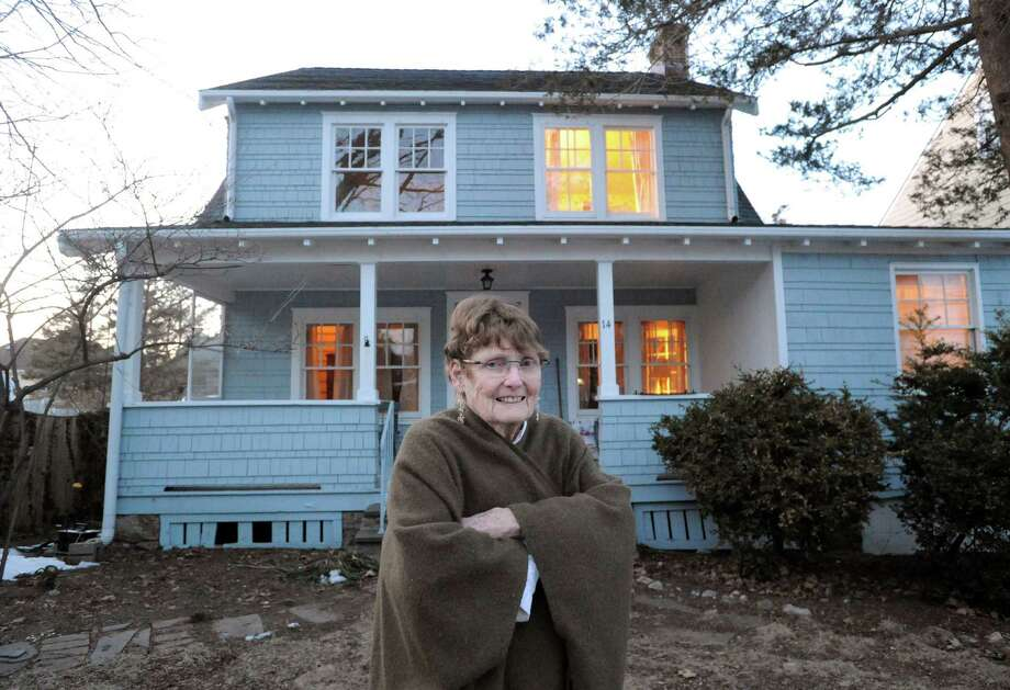 "Aileen White outside her home that was being used as a location set for the film ""Boychoir,"" staring Dustin Hoffman, Kathy Bates and Sissy Spacek at 14 Lanark Rd., Stamford, Conn., Thursday night, March 6, 2014. The film could be the last big-budget feature film to shoot in Connecticut for a while as the state has terminated its tax credit program for movies. Photo: Bob Luckey / Greenwich Time"