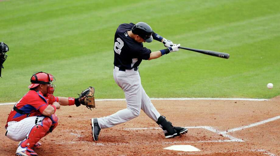 New York Yankees' Derek Jeter, right, hits a single in front of Phillies catcher Carlos Ruiz during the third inning of an exhibition baseball game against the Philadelphia Phillies, Thursday, March 6, 2014, in Clearwater, Fla. (AP Photo/Charlie Neibergall) ORG XMIT: FLCN110 Photo: Charlie Neibergall / AP