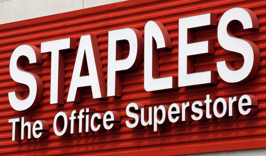 FILE - In this May 17, 2011 file photo, a Staples sign is displayed on the front of a Staple store, in Portland, Ore. Staples says it will shutter 225 North American stores, about 10 percent of Staples Inc.'s worldwide total of 2,200, by the end of 2015, and the office-supply retailer has started a plan to save about $500 million annually. (AP Photo/Rick Bowmer, File) ORG XMIT: NY110 Photo: Rick Bowmer / AP