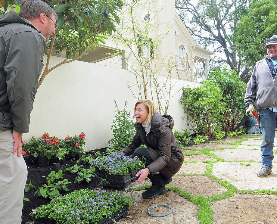 Landscape architect Johnny Steele (at left) and homeowner Meredith Cocke discuss color as crew prepare for the annual azalea trail at her residence Monday 03/03/14. Photo by Tony Bullard. Photo: Â Tony Bullard 2014, Freelance Photographer / © 2014 Tony Bullard