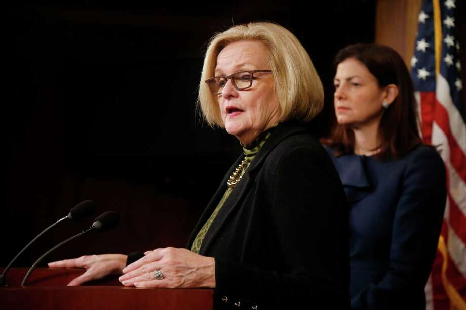 Sen. Claire McCaskill, D-Mo., left, and Sen. Kelly Ayotte, R-N.H., participate in a news conference on Capitol Hill in Washington, Thursday, March 6, 2014, following a Senate vote on military sexual assaults  The Senate blocked a bill that would have stripped senior military commanders of their authority to prosecute rapes and other serious offenses, capping an emotional, nearly yearlong fight over how best to curb sexual assault in the ranks. (AP Photo/Charles Dharapak) Photo: Charles Dharapak, STF / AP