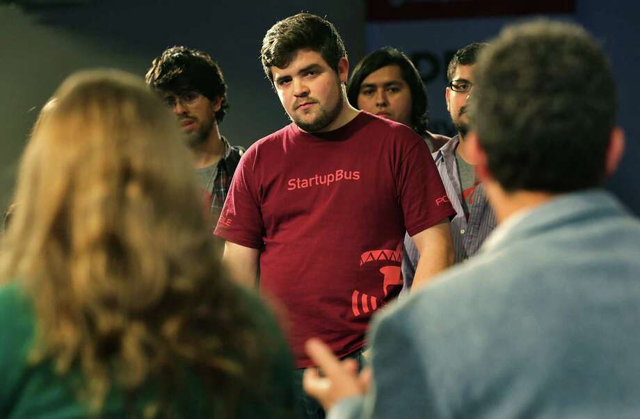 Jorge Rios (center) and his teammates in StartupBus Bridgefy from Mexico listen to the competition's judges  at Rackspace. Photo: Photos By Bob Owen / San Antonio Express-News / © 2012 San Antonio Express-News