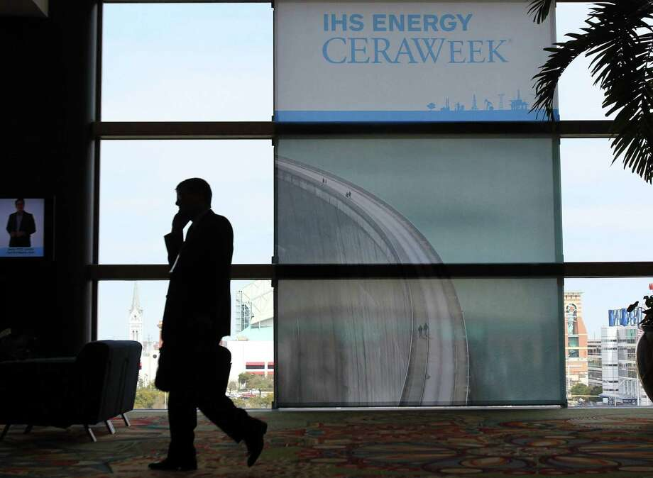 People arrive at the IHS CERAWeek energy summit in Houston. Photo: Mayra Beltran / Houston Chronicle / © 2014 Houston Chronicle