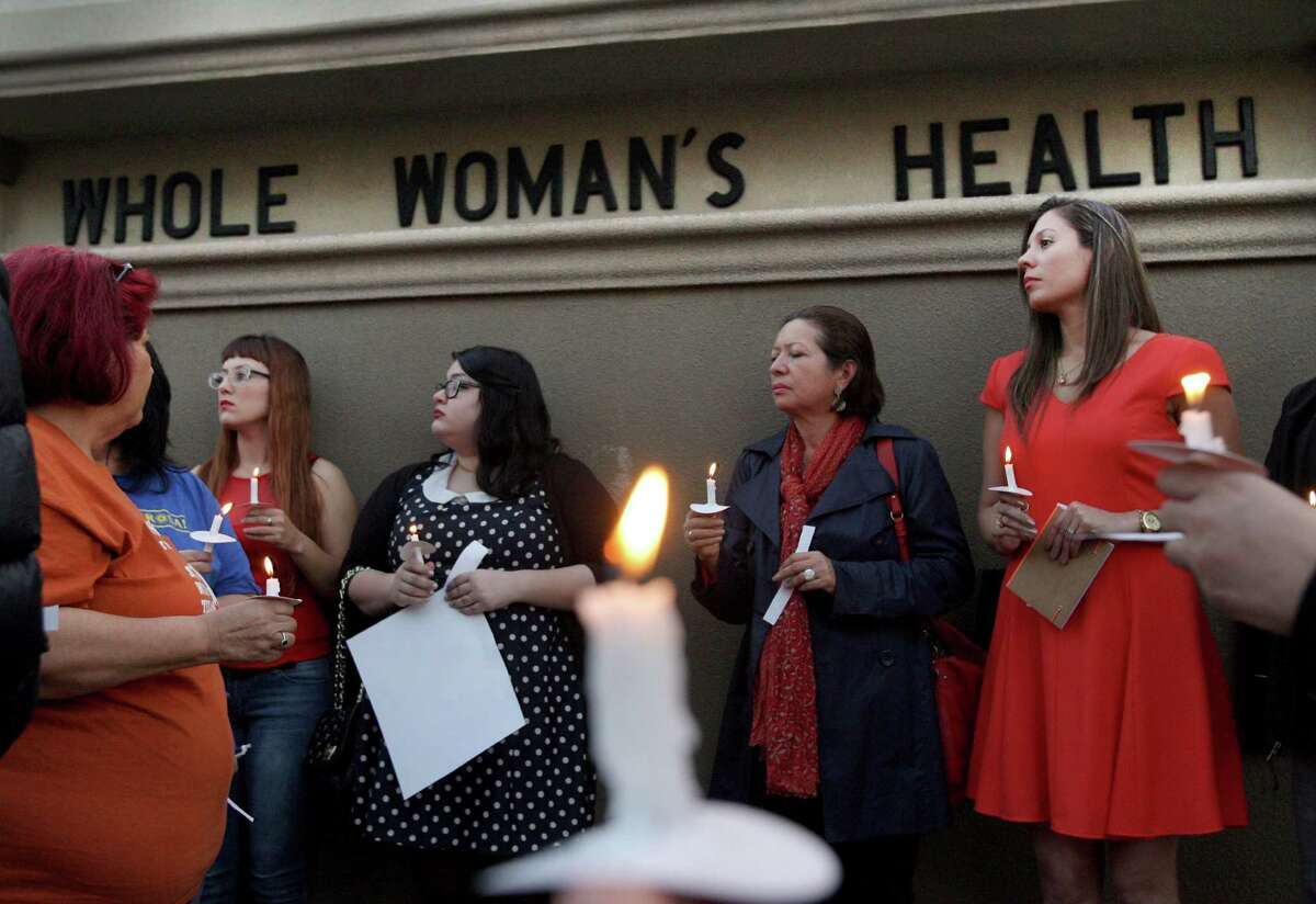 Over 40 people held a candle light vigil in front of the Whole Women's Health Clinic in McAllen Thursday March 6, 2014. (AP/Photo/ Delcia Lopez/ The Monitor)