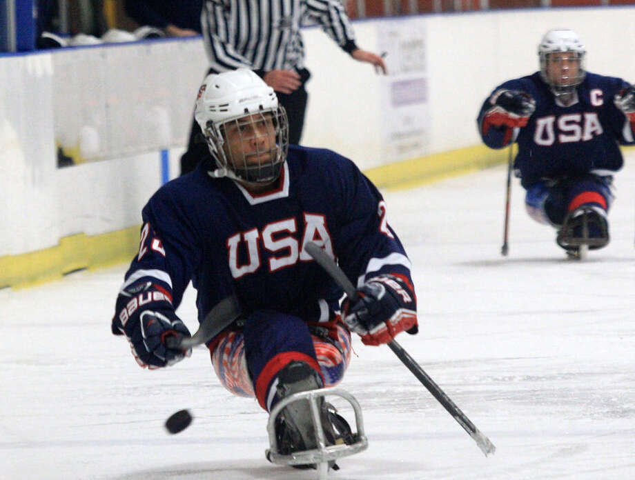 Rico Roman, playing in an exhibition in North Carolina on Jan. 10, is one of three San Antonio residents who will compete on the U.S. sled hockey team at the Paralympic Winter Games. Photo: Gregg Forwerck / USA Hockey / Gregg Forwerck Sports