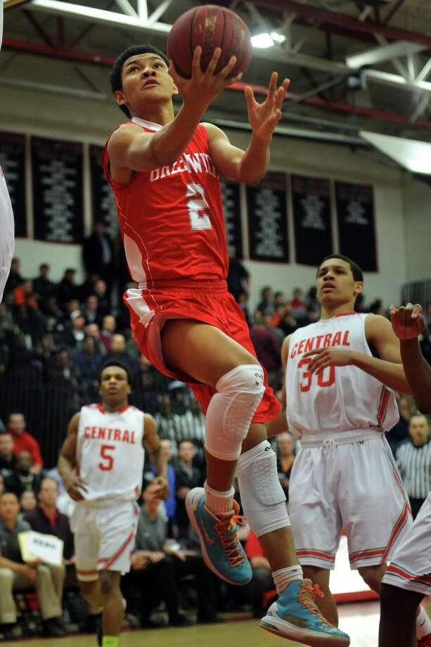 Greenwich's CJ Byrd puts up the ball during the FCIAC championship game against Central Thursday, Mar. 6, 2014, at Fairfield Warde High School in Fairfield, Conn. Photo: Autumn Driscoll / Connecticut Post