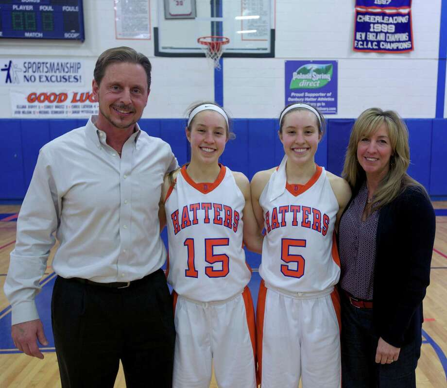 Danbury's Rebecca Gartner (15) scored her 1,000th point during the Class LL girls basketball state tournament second round game between Simsbury and Danbury, at Danbury High School, on Thursday, March 6, 2014. She is joined by her sister Rachel Gartner (5) who also scored her 1,000th point this season, and her parents Willi Gartner and Cheryl gartner. Photo: H John Voorhees III / The News-Times Freelance