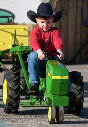 Joseph Woloson, 6, participates in the kids tractor pull during the Houston Livestock Show and Rodeo