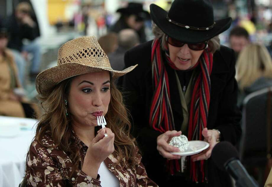 Karla Barguiarera is pleasantly surprised by a food sample while judging the Gold Buckle Foodie Awards at the Houston Livestock Show and Rodeo on March 6, 2014, in Houston. Photo: Mayra Beltran, Houston Chronicle / © 2014 Houston Chronicle