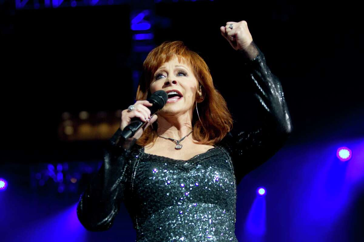 Country music singer Reba McEntire performing at RodeoHouston in 2014.