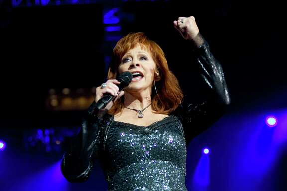 Country music singer Reba performs at Reliant Stadium during the Houston Livestock Show and Rodeo, Thursday, March 6, 2014, in Houston.