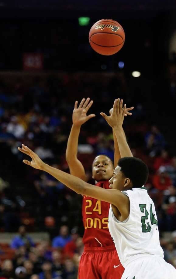 Houston Yates' Jacob Young (24) shoots during a boys' UIL Class 3A state basketball semifinal against Kennedale, Thursday, March 6, 2014, in Austin, Texas. Yates defeated Kennedale 86-79. (AP Photo/Tamir Kalifa) Photo: Tamir Kalifa, Associated Press / FR170773 AP