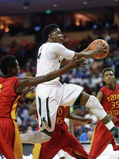 Kennedale's Ty Charles (44) drives past Houston Yates players on the way to the basket during a boys