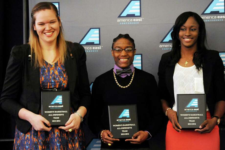 UAlbany's Megan Craig, left, Tammy Phillip, center, and Shereesha Richards are named part of America East's basketball All-Defensive Team during an awards reception on Thursday, March 6, 2014, at UAlbany in Albany, N.Y. (Cindy Schultz / Times Union) Photo: Cindy Schultz / 00025985A