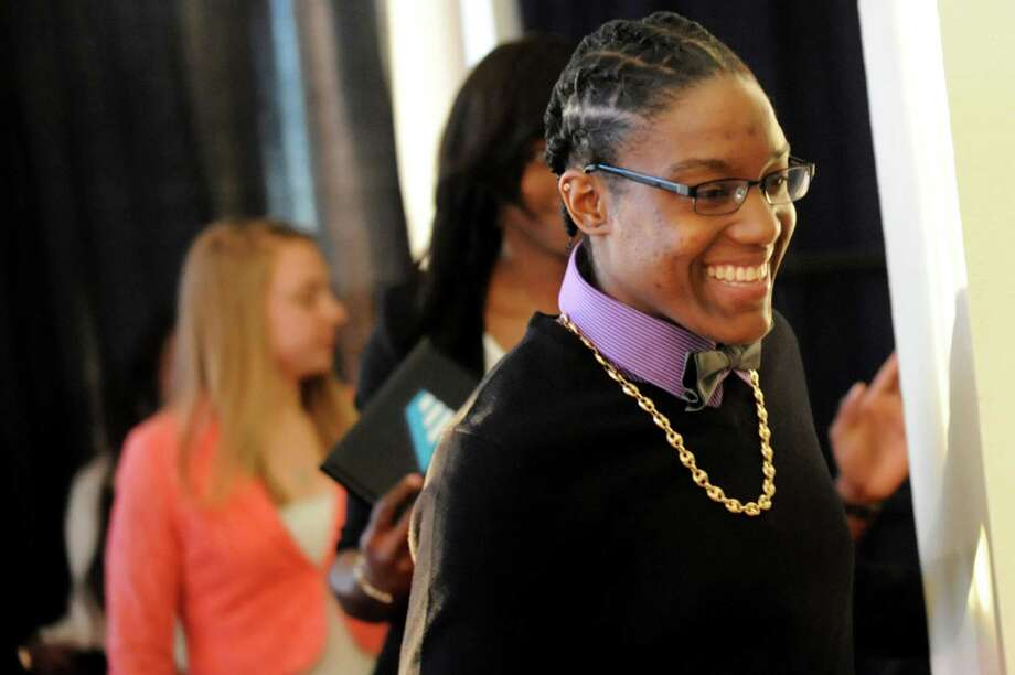 UAlbany's Tammy Phillip, right, is all smiles when she's named part of America East's basketball All-Defensive Team during an awards reception on Thursday, March 6, 2014, at UAlbany in Albany, N.Y. (Cindy Schultz / Times Union) Photo: Cindy Schultz / 00025985A
