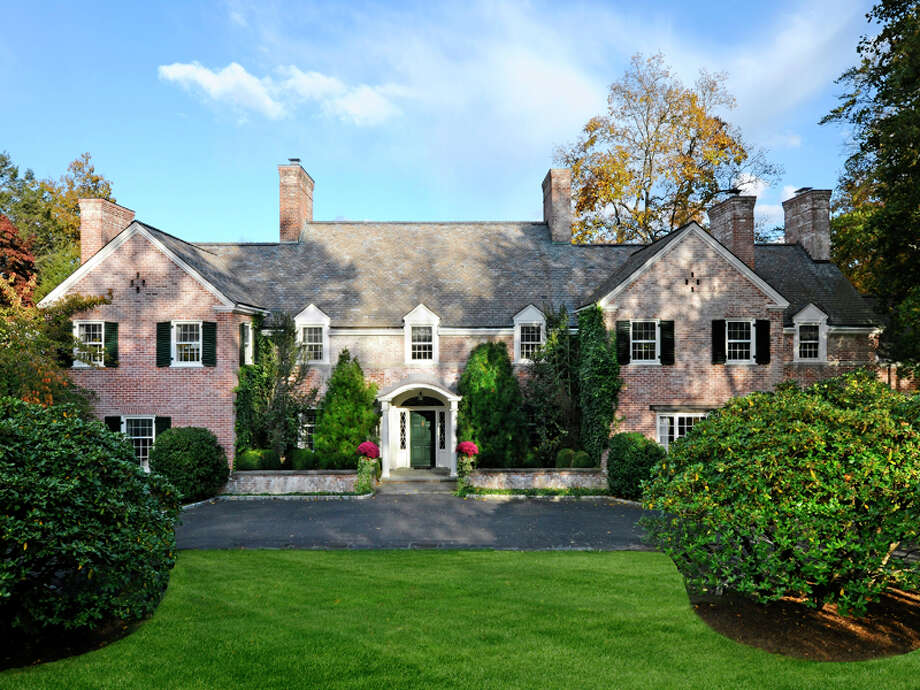 This 9,200-square-foot Georgian mansion at 11 Meadowcroft Lane in Greenwich was built in 1938. It was once the home of IBM's Thomas Watson Jr., said Bill Andruss of Sotheby's, and is now the market for $7.8 million. Photo: Contributed, Contributed Photo / Greenwich Time