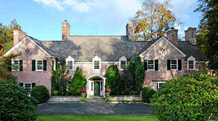 This 9,200-square-foot Georgian mansion at 11 Meadowcroft Lane in Greenwich was built in 1938. It was once the home of IBM's Thomas Watson Jr., said Bill Andruss of Sotheby's, and is now the market for $7.8 million.