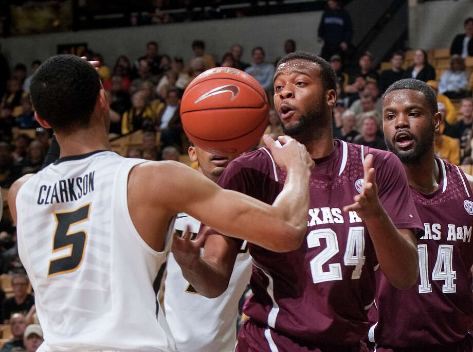 Missouri's Jordan Clarkson, left, and Texas A&M's Antwan Space, center, play hot potato Wednesday. The Aggies lost to diminish their postseason aspirations. Photo: L.G. Patterson, FRE / FR23535 AP