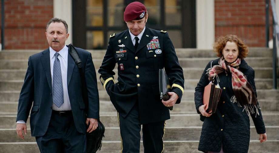 Brig. Gen. Jeffrey Sinclair leaves the courthouse with his lawyers Richard Scheff and Ellen Brotman. Photo: James Robisnson / Fayetteville Observer / The Fayetteville Observer