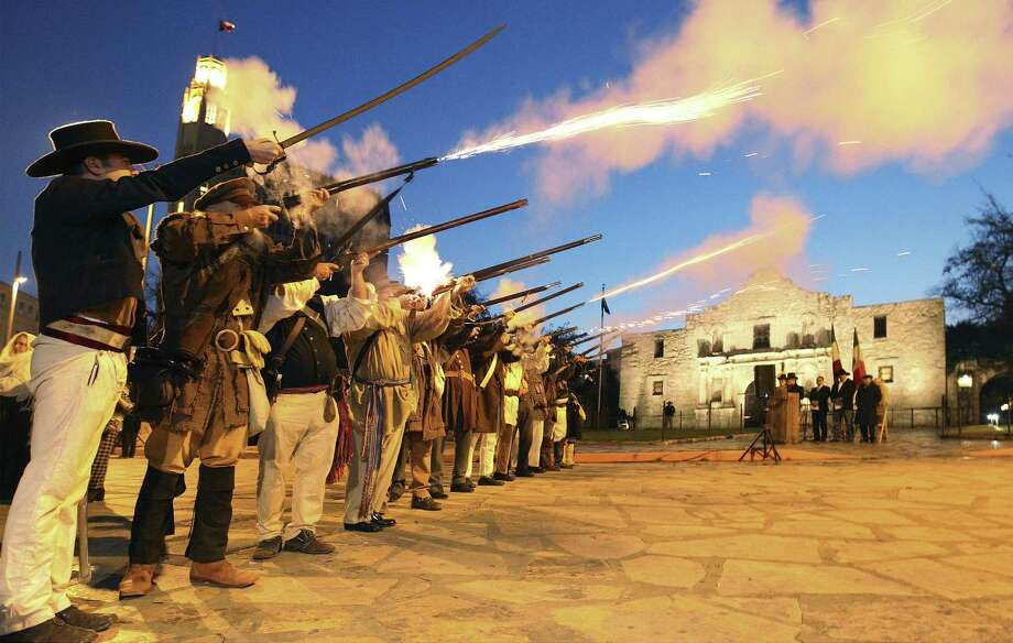 "Members of the San Antonio Living History Association fire muskets in front of the chapel during the annual ""Dawn at the Alamo"" ceremony. Thursday marked the 178th anniversary of the battle during the fight for Texas independence. Photo: Photos By Kin Man Hui / San Antonio Express-News / ©2013 San Antonio Express-News"