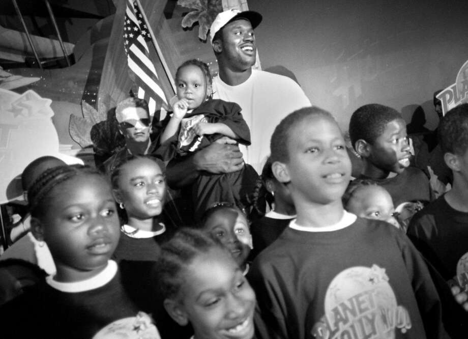 """Shaq is a big supporter of the Boys and Girls Club of America, because he says they gave him a safe place to play when he was a kid. """"It gave me something to do,"""" he told Parade magazine in 2000. """"I'd just go there to shoot. I didn't even play on a team.""""PHOTO: Shaquille O'Neal poses for a picture with kids from the Boys and Girls Club at Planet Hollywood in Washington, D.C., on Aug. 5, 1998. Photo: Juana Arias, Washington Post/Getty Images"""