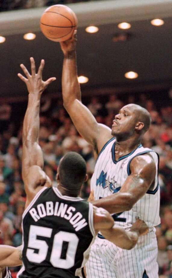 In his second season in the NBA (1993-94), Shaq's scoring average was second in the league, behind the Spurs' David Robinson. In his third season, Shaq led the league in scoring, but finished second in MVP voting -- to the Spurs' David Robinson.
