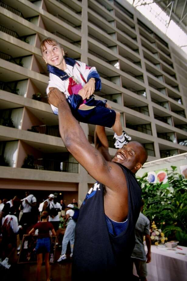 Shaq won a gold medal as part of the U.S. basketball team at the Atlanta Olympics in 1996.PHOTO: Shaquille O'Neal lifts up Dominique Moceanu of the USA gymnastics team at the 1996 Centennial Olympic Games in Atlanta, Ga. Photo: Getty Images